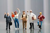 image of population  - Line of diverse tiny miniature model people in population demographics representing a cross section of the community including a housewife artisan labourer and professionals - JPG