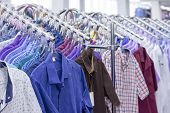 Clothes Hang On A Shelf . Cloth Hangers With Shirts. Mens Business Clothes. Clothing Supermarket poster