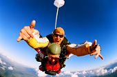 foto of parachute  - Tandem skydiver in action parachuting - JPG