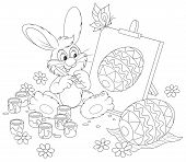 stock photo of cony  - Funny rabbit drawing a decorated Easter egg to the upcoming holiday - JPG
