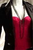 foto of camisole  - a mannequin wear suit with red camisole - JPG