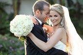 picture of kiss  - Happy bride and groom on their wedding - JPG