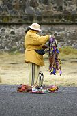 foto of peddlers  - Aztec ruins in Mexico is no exception to peddlers pushing their souvenirs - JPG