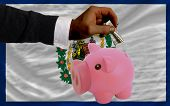 Dollar Into Piggy Rich Bank And  Flag Of American State Of West Virginia