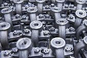 stock photo of penetration  - Industrial background from part of assembled valves - JPG