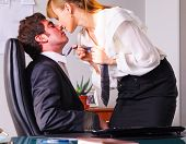 picture of seduce  - businesswoman is seducing her boss at office - JPG