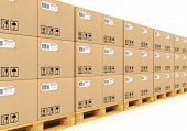 image of wooden pallet  - Shipment logistics delivery and product distribution business industrial concept: row of stacked cardboard boxes with packed goods on wooden shipping pallets isolated on white background