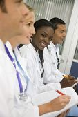 stock photo of medical staff  - group of doctors in a meeting working in a case at the hospital - JPG