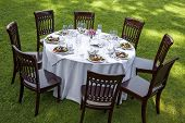 stock photo of lawn chair  - Table setting with chairs for garden banquet - JPG