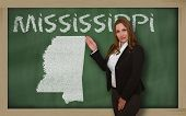 Teacher Showing Map Of Mississippi On Blackboard