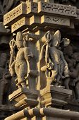 stock photo of khajuraho  - Human Sculptures at Vishvanatha Temple,  Western temples of Khajuraho,  Madhya Pradesh,  India. Khajuraho is an UNESCO world heritage site popular for tourists all over the world.