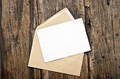 stock photo of edging  - Blank card and envelope on old wooden background - JPG