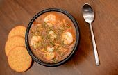 stock photo of creole  - cajun meal of shrimp gumbo on wood background - JPG