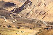 stock photo of sherpa  - Highway at the Pangla pass near Lhasa - JPG