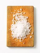 stock photo of crystal salt  - crystal salt on a wooden cutting board - JPG