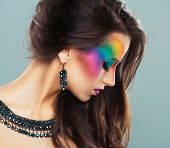 Portrait Of A Young Beautiful Girl With A Fashion Bright Multicolored Makeup