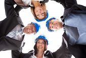 picture of huddle  - Group Happy Architects Making Huddle Over White Background - JPG