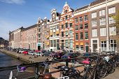 Amsterdam, Netherlands - March 19, 2014: Colorful Houses Facades On The Canal Embankment