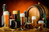 stock photo of differences  - still life with different bottles glasses and mugs of beer drinks - JPG