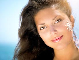 pic of sun tan lotion  - Suntan Lotion Woman Applying Sunscreen Solar Cream - JPG