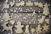 stock photo of ginger bread  - Ginger Breads Building Frame on Planks in the Snow and with Copy Space - JPG