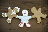 picture of ginger bread  - Three Happy Looking Ginger Bread Man Different Cookies with Decoration or Blank Wooden Background - JPG