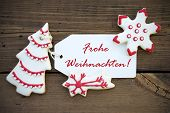 pic of weihnachten  - Red and white Christmas Cookies with Decoration and a red german Frohe Weihnachten which means Merry Christmas on a white Label - JPG