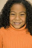 stock photo of pacific islander ethnicity  - Pacific Islander girl with curly hair - JPG