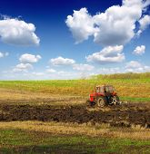 stock photo of plowing  - Tractor plowing - JPG