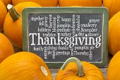 stock photo of slating  - cloud of words related to celebration of Thanksgiving Day on a  slate blackboard surrounded by pumpkins - JPG