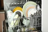 image of dishwasher  - Open dishwasher with clean utensils in it - JPG
