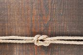 stock photo of marines  - Marine knot on wooden background - JPG