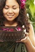 pic of pacific islander ethnicity  - Pacific Islander woman holding spa treatment bowl - JPG