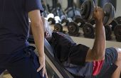 picture of personal trainer  - Selective focus of a personal trainer working with a male client - JPG