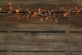 picture of diodes  - Christmas lights on wooden background - JPG