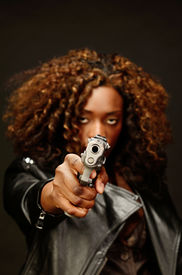 picture of gangsta  - A young beautiful african american female holds a semi automatic pistol during this dark photo shoot against black - JPG