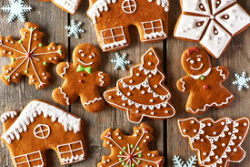 stock photo of gingerbread man  - Christmas homemade gingerbread cookies on wooden table - JPG