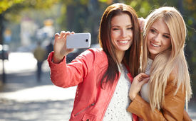 stock photo of selfie  - Friends making selfie - JPG