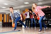 picture of bowling ball  - Friends playing in bowling club - JPG