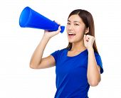 foto of yell  - Woman yells to megaphone - JPG