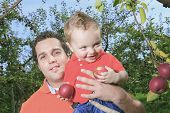 stock photo of piggyback ride  - Father giving piggyback ride to his son - JPG
