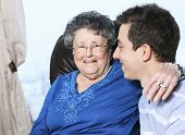 stock photo of grandmother  - A grandchild with his grandmother in his room - JPG