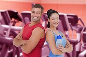 image of treadmill  - Fit man and woman smiling at camera together against close up of treadmills in a fitness centre - JPG