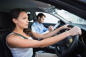 stock photo of driving  - Young woman getting a driving lesson in the car - JPG