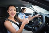 picture of driving  - Young woman getting a driving lesson in the car - JPG