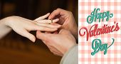 foto of propose  - Close up on man putting on ring during marriage proposal against happy valentines day - JPG
