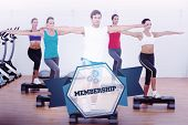 image of step aerobics  - The word membership and fitness class performing step aerobics exercise against hexagon - JPG