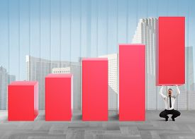 stock photo of strongman  - Business strongman with effort lifts company statistics - JPG