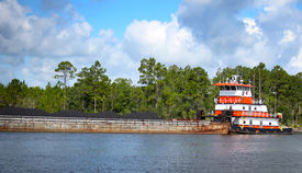 stock photo of coal barge  - The Sacred Heart pusher boat is anchored in West Bay with three barges of coal near Panama City Beach Florida - JPG