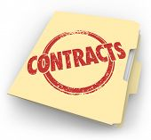 image of clientele  - Contracts word  stamped on a manila folder full of agreements - JPG